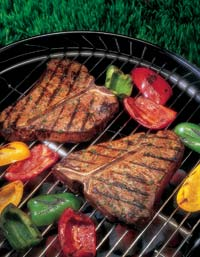 Steaks grilling on the barbeque